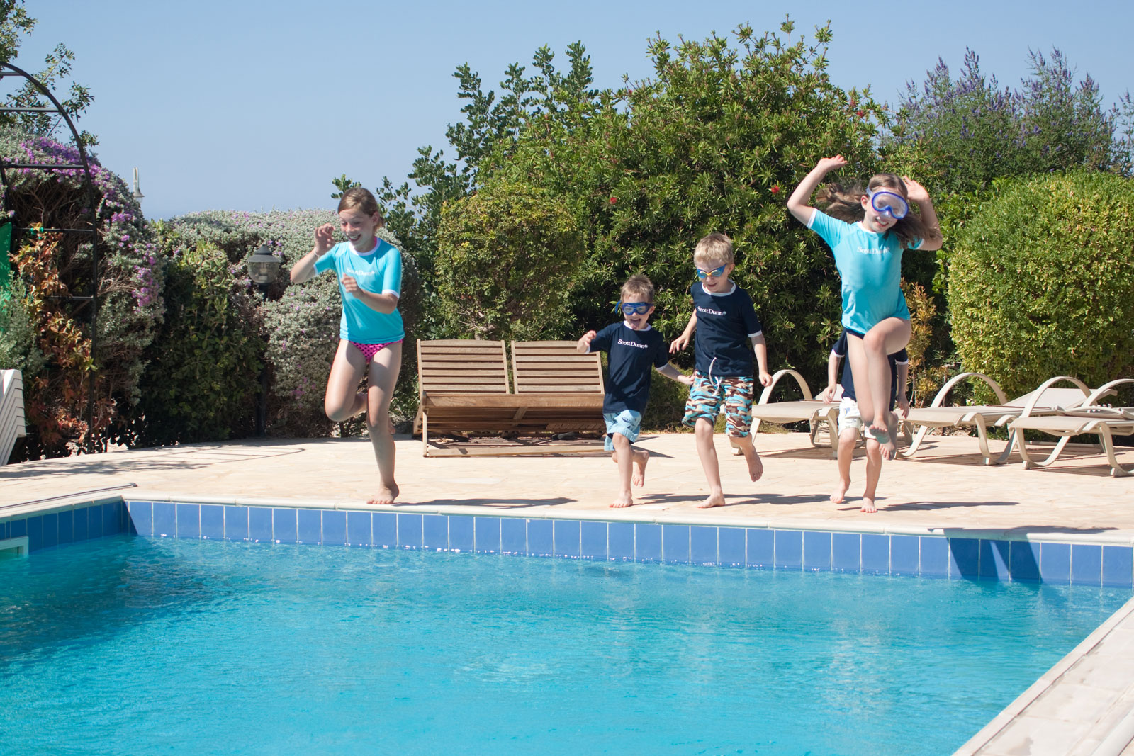 Scott-Dunn Cyprus Kids Jumping into pool happy